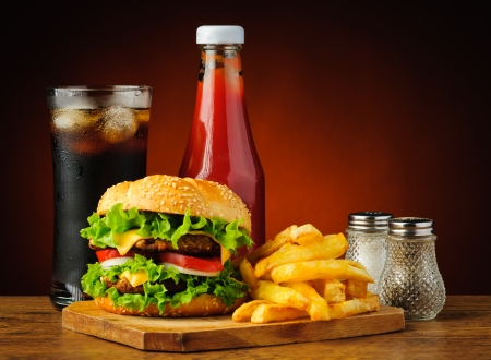 burger and fries: still life with fast food hamburger menu, french fries, soft drink and ketchup