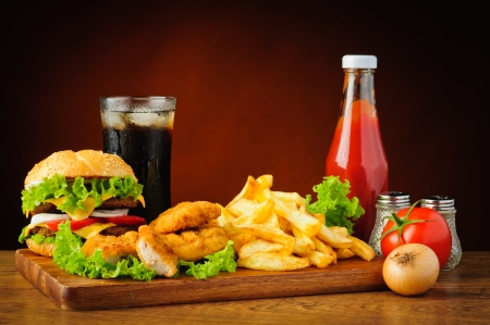 drink: fast food menu with hamburger or cheeseburger, traditional french fries, chicken nuggets, cola and tomato ketchup