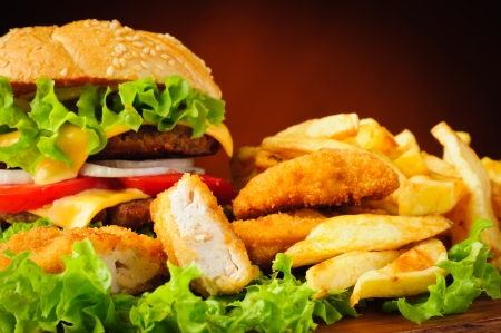 Fast food menu with chicken nuggets, hamburger and french fries photo