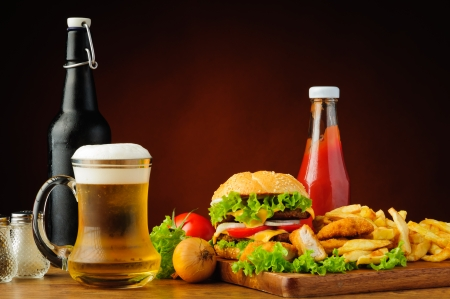 fast food menu with hamburger, chicken nuggets, french fries and beer photo