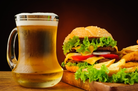 still life with fast food and fresh cold beer photo