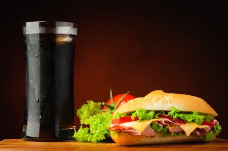 ciabatta: still life with sandwich, vegetables and cola drink