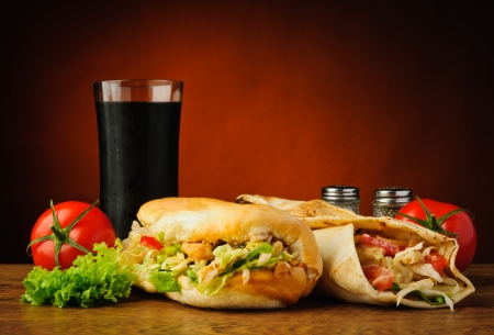 doner: still life with traditional turkish kebab, shawarma, vegetables and cola Stock Photo