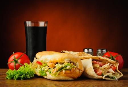 still life with traditional turkish kebab, shawarma, vegetables and cola Standard-Bild