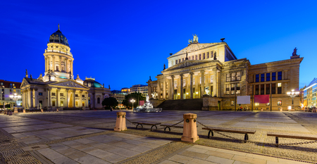 dom: panorama cityscape with german cathedral and konzerthaus in berlin, germany, at night