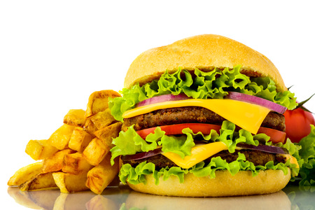 hamburger closeup with french fries isolated on a white background photo