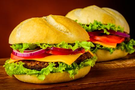 hamburgers: still life with two delicious american hamburgers or cheeseburgers