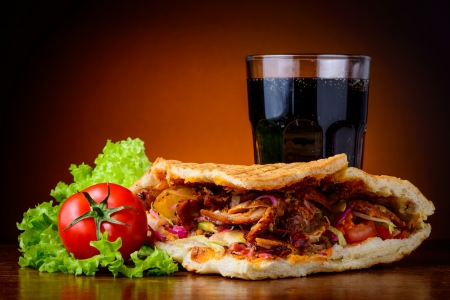 still life with doner kebab, fresh vegetables and cola drink Stock Photo