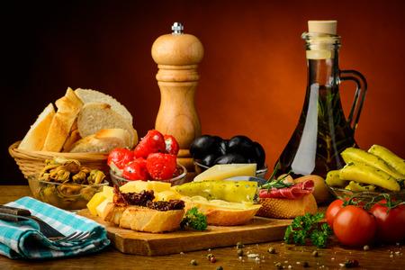 still life with traditional mediterranean tapas snacks food