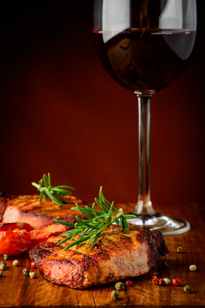 still life with grilled meat and glass of red wine Stock Photo