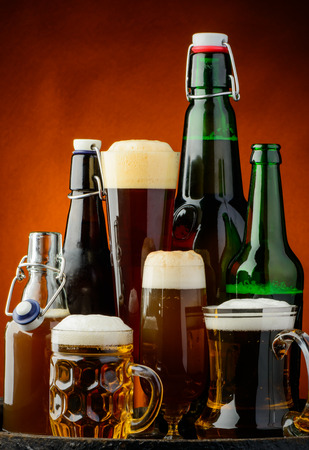bottle of beer: still life background with different bottles of beer