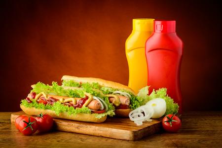 hotdog: fast food hot dog menu with hotdogs, ketchup, mustard and vegetables