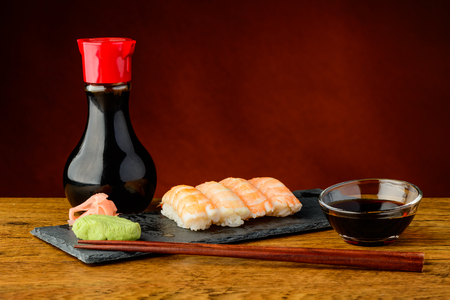 still life with nigiri sushi with prawns and soy sauce photo