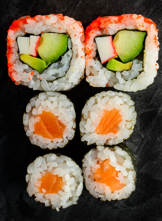 mixed sushi plate with maki and uramaki california rolls photo