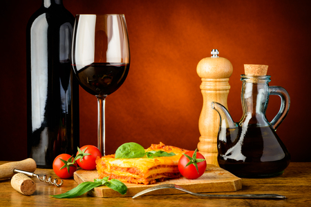 lasagna: traditional dinner with lasagne bolognese and red wine