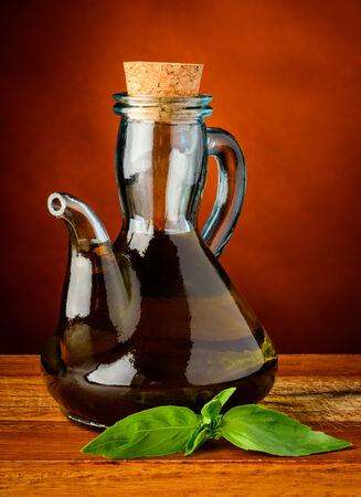 extra: bottle of extra virgin olive oil and fresh green basil Stock Photo