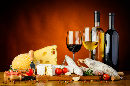 still life with traditional cheese, sausages food and wine