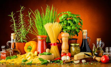still life with traditional italian pasta ingredients, herbs and spices
