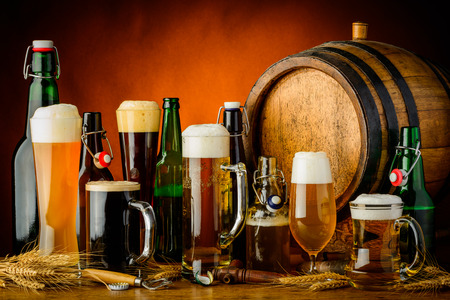 beer barrel: still life with different bottles, glasses and mugs of beer drinks