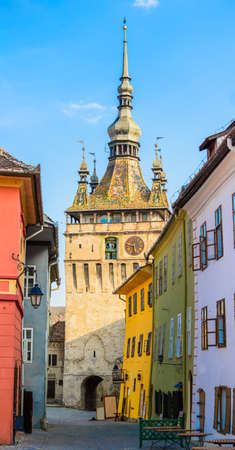 clock tower in historic center of sighisoara, transylvania, romania photo