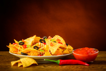 chips and salsa: still life with tortilla chips, salsa dip and red chili pepper Stock Photo