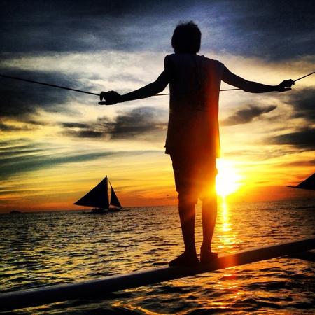 boatman: Boatman watching the sunset