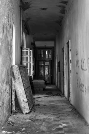 Abandoned Asylum hallway with dirty mattress and crumbly walls Stock Photo