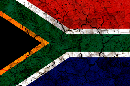 south africa country flag symbol painted on a cracked grungy wall. Concept of drought, hardship, no rain or economic crisis