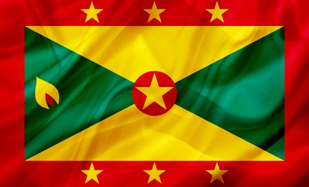 Grenada country flag symbol on silk or silky waving texture. Smooth fabric or material