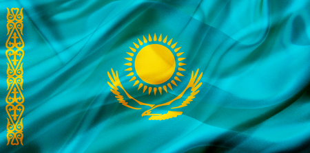 Kazakhstan country flag symbol on silk or silky waving texture. Smooth fabric or material