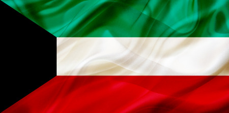 Kuwait country flag symbol on silk or silky waving texture. Smooth fabric or material