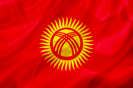 Kyrgyzstan country flag symbol on silk or silky waving texture. Smooth fabric or material Stock fotó