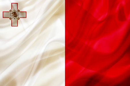 Malta country flag symbol on silk or silky waving texture. Smooth fabric or material