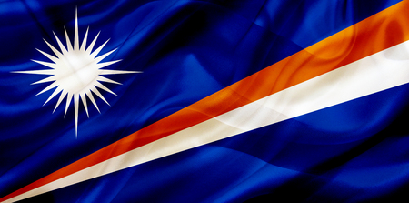 Marshall Islands country flag symbol on silk or silky waving texture. Smooth fabric or material