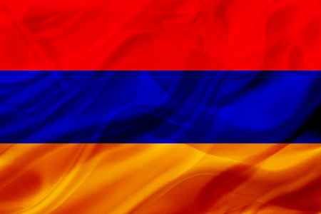 Armenia country flag symbol on silk or silky waving texture. Smooth fabric or material