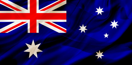 Australia country flag symbol on silk or silky waving texture. Smooth fabric or material Stok Fotoğraf