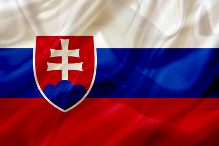 Slovakia country flag symbol on silk or silky waving texture. Smooth fabric or material Stok Fotoğraf