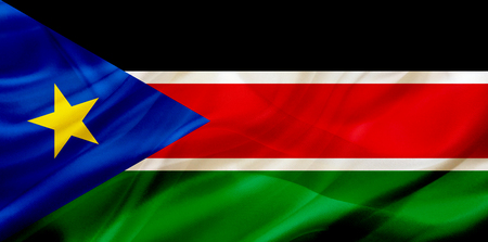 South Sudan country flag symbol on silk or silky waving texture. Smooth fabric or material