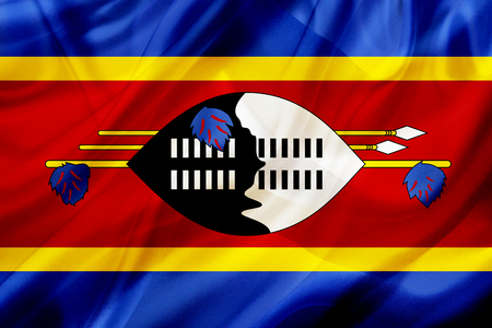 Swaziland country flag symbol on silk or silky waving texture. Smooth fabric or material Banque d'images - 123545833