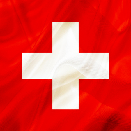 Switzerland country flag symbol on silk or silky waving texture. Smooth fabric or material Banque d'images - 123545835