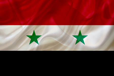 Syria country flag symbol on silk or silky waving texture. Smooth fabric or material Banque d'images - 123545836