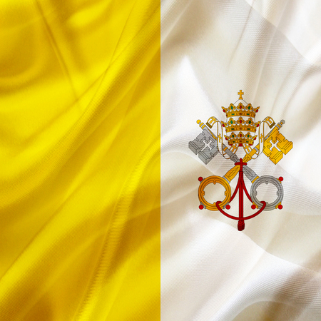 The Vatican City country flag symbol on silk or silky waving texture. Smooth fabric or material Banque d'images - 123545843