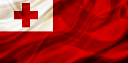 Tonga country flag symbol on silk or silky waving texture. Smooth fabric or material Banque d'images - 123545845