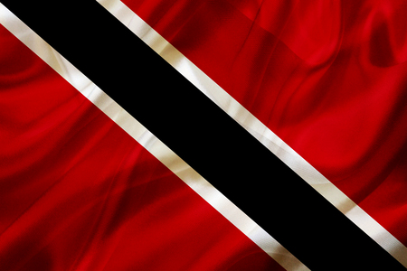 Trinidad and Tobago country flag symbol on silk or silky waving texture. Smooth fabric or material Banque d'images - 123545846