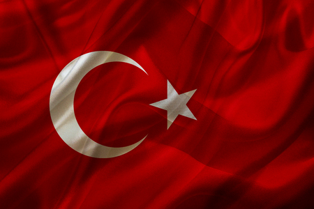 Turkey country flag symbol on silk or silky waving texture. Smooth fabric or material Stock fotó