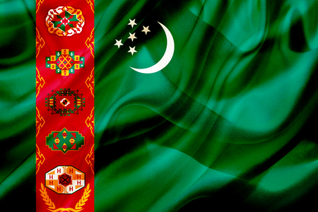 Turkmenistan country flag symbol on silk or silky waving texture. Smooth fabric or material Banque d'images - 123545849