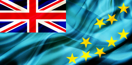 Tuvalu country flag symbol on silk or silky waving texture. Smooth fabric or material Banque d'images - 123545850