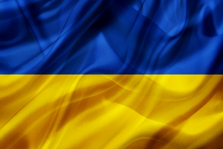 Ukraine country flag symbol on silk or silky waving texture. Smooth fabric or material Banque d'images - 123545853