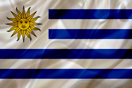 Uruguay country flag symbol on silk or silky waving texture. Smooth fabric or material Banque d'images - 123545855
