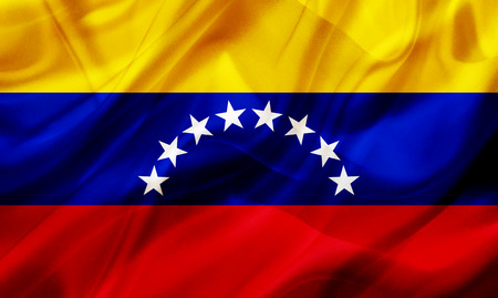 Venezuela country flag symbol on silk or silky waving texture. Smooth fabric or material Banque d'images - 123545859